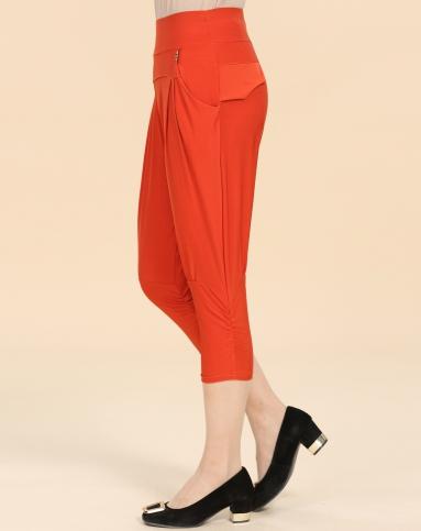 橘红色休闲七分哈伦裤